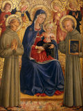 Bartolommeo Caporali: Madonna and Child with St. Francis and Bernardine stock photography