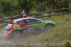 Barum Czech Rally 2009 IRC. ZLIN, CZECH REP. - AUGUST 23, Driver Kuzaj Leszek and co-driver Hundla Robert in car Peugeot 207 s2000 at speed stage no.13 during Royalty Free Stock Photos