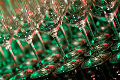 Barware wine glasses. And stems, lined up and ready to be filled Royalty Free Stock Photo