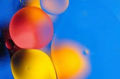 Barwi abstrakcjonistycznego tło opierającego się na czerwieni, kolorów żółtych owale i okręgi i Obraz Stock