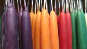 Barwione świeczki wiesza z rzędu Obraz Royalty Free