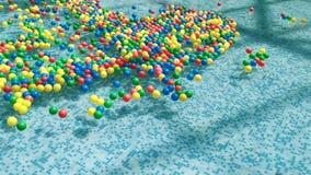 Barwione piłki unosi się i rusza się w wodzie zbiory