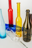 Barwione szklane butelki Obrazy Stock