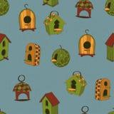 Barwioni birdhouses na błękitnym tle Obrazy Royalty Free