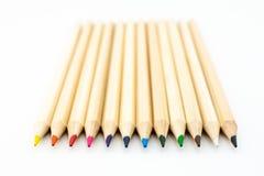 Barwioni drewniani ołówki odizolowywający obraz royalty free