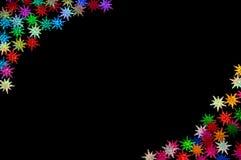 Barwioni gwiazda confetti na czerni fotografia stock