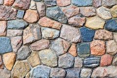 Barwioni kamienie w popielatej ścianie Fotografia Royalty Free