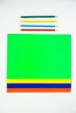 Barwioni kartonowi i barwioni ołówki na białym tle Obraz Royalty Free