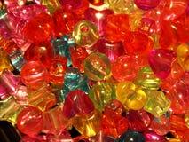 Barwioni koraliki w formie serc, gwiazdy, piłki Zdjęcie Stock