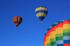 Barwioni lotniczy balony przy niebieskim niebem Obrazy Stock