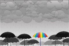 Barwioni parasole w deszczu Zdjęcie Royalty Free