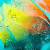 Barwioni punktów okręgi na wodzie Zdjęcia Stock