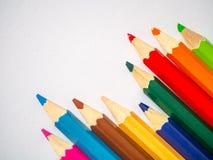 Barwiony ołówek odizolowywający na popielatym sztuka papierze Obraz Stock