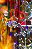 Barwiony szkło i miedziany wiatrowy chime, fotografia stock