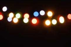Barwiony świecenie od girlandy na tle Zdjęcie Royalty Free