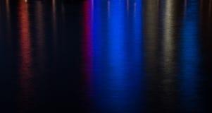 Barwiony wodny tło od miast świateł Obraz Royalty Free