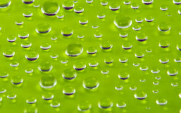 barwionych kropelek nawierzchniowa woda Fotografia Stock