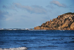 Barwon Heads Cliff. With waves breaking on a reef Royalty Free Stock Image