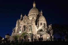 Basílica de Sacre Coeur en la noche Fotos de archivo