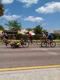 Bas cavalier sur un tricycle Image stock