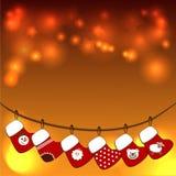 Bas de Noël sur une corde Photographie stock libre de droits