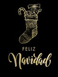 Bas de scintillement d'or de Feliz Navidad Spanish Merry Christmas Photographie stock