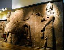 Bas del lamassu con alas humano-dirigido de las estatuas del toro aka - 31-10-2011 Foto de archivo