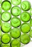 Bas des bouteilles en verre vides Photographie stock
