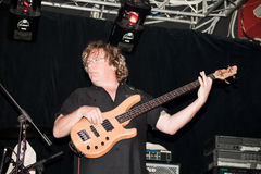 bas- gitarristhamm stuart Arkivfoto