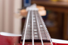 Bas guitar frets neck blured focus.  Royalty Free Stock Photo