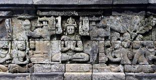 Bas-lättnad på väggen i det Borobudur tempelet royaltyfri fotografi