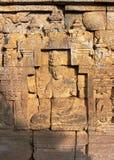 Bas-lättnad på väggen i det Borobudur tempelet arkivbild