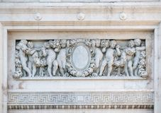 Bas-relevo antigo de mármore do bebê Imagem de Stock Royalty Free
