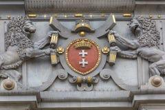 Bas-relevo decorativo na fachada da porta do Upland, Gdansk, Pol?nia fotografia de stock