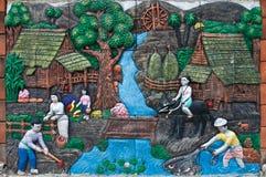 Bas-relevo dos fazendeiros Tailândia Foto de Stock Royalty Free