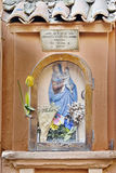 Bas-relief. Of Virgin Mary in a wall in Tuscany, Italy Royalty Free Stock Photography