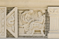 Bas-relief. The bas-relief on a stone wall stock images