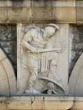 Bas-relief. Of a warrior on the wall royalty free stock photography