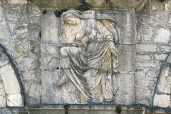 Bas-relief. Old bas-relief of a woman on the stone wall stock photos