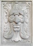 Bas-relief. As a person fragment of wall of age-old building Stock Photo