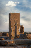 Bas Relief of Achaemenid King With Two Attendants Holding an Umbrella in Persepolis Royalty Free Stock Images