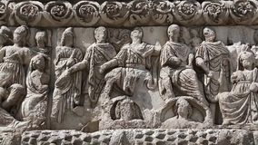 Bas-relief on the ancient Arch of Galerius in Thessaloniki, Greece. The tetrarchs arrayed in unison with a Victoria holding a victory wreath to the Augusti stock footage