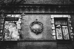 Bas-relief. An ancient bas-relief on the building, between two windows Royalty Free Stock Images