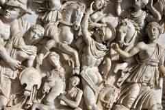 Bas-relief of ancient Roman soldiers. Bas-relief and sculpture of ancient Roman soldiers Stock Images