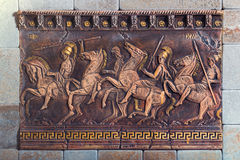 Bas relief of the ancient soldiers on the battle horses Royalty Free Stock Photo