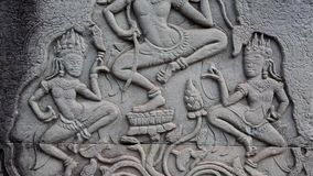 Bas-relief on the ancient wall in Angkor Thom temple complex in Cambodia. Apsara dance stock footage