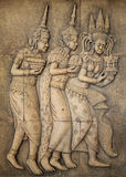 Bas-relief in Angkor wat. Bas-relief of Khmer civilization in a sandstone wall Stock Images