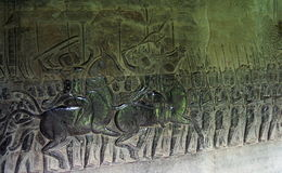Bas relief in Angkor Wat. Siem Reap. Cambodia. Bas relief 'Battle of Kurukshetra' (coming from the Hindu Mahabharata epic) on the southern portion of the west Stock Images