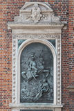 Bas-relief art on St. Mary's Basilica exterior in Krakow. Royalty Free Stock Images