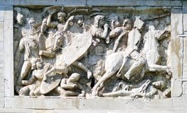 Bas-relief with the battle scene. Bas-reliefs and sculptures on the triumphal arch of the Constantine emperor in Rome Royalty Free Stock Photo